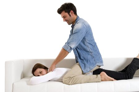 man massaging the shoulders of a woman photo