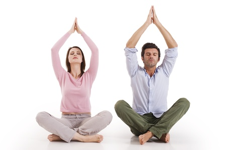meditating woman: Couple practicing yoga