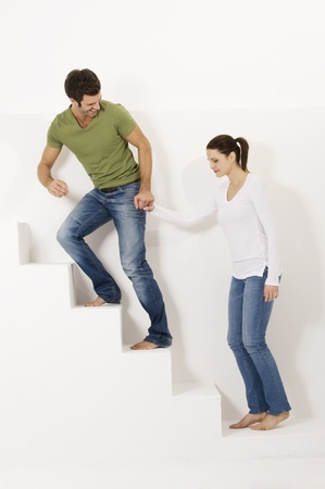 Couple up the stairs holding hands photo