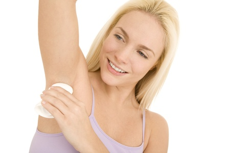 armpits: woman applying deodorant under her armpits Stock Photo