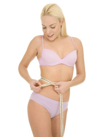 woman measuring the waist with a tape photo
