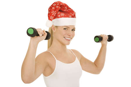christmas tattoo: woman with Santa Hat lifts weights