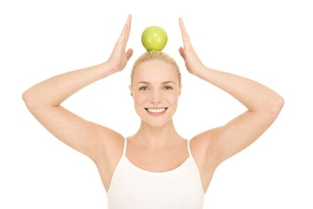 aliments: woman with green apple on the head Stock Photo
