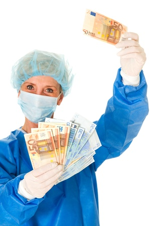 female surgeon: female surgeon holding banknotes