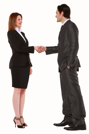 hands on pockets: businessman and businesswoman shaking hands