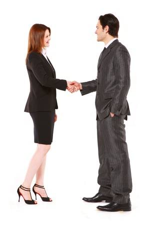 hands in pockets: businessman and businesswoman shaking hands