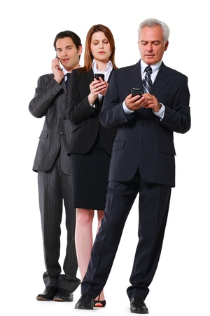 business attire: two businessman and one businesswoman with mobile