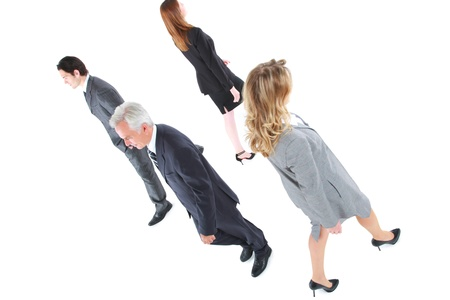tailleur: businessman and businesswoman walking in different directions Stock Photo