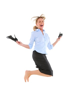 businesswoman jumping with shoes in hand photo