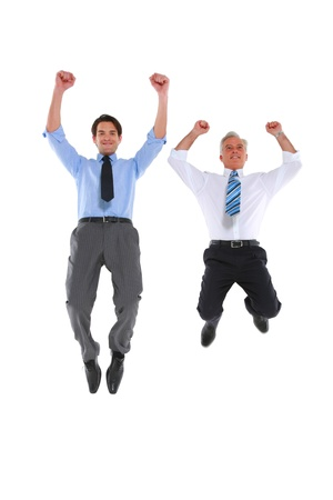 only two people: two businesswoman jumping and rejoicing Stock Photo
