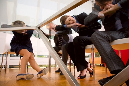 tailleur: businessman and businesswoman exhausted during a meeting Stock Photo
