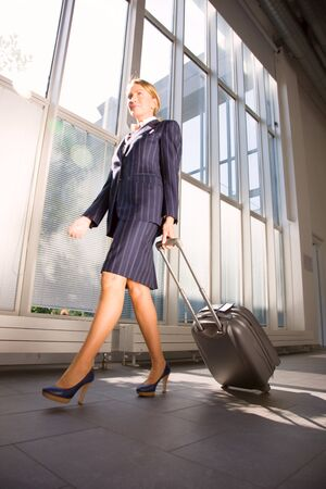 businesswoman with trolley photo