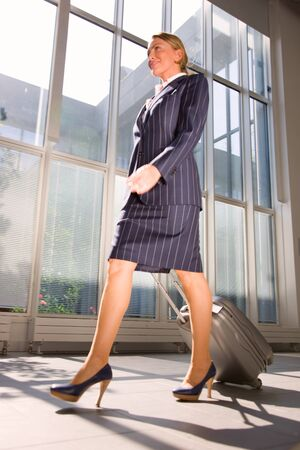 tailleur: businesswoman with trolley