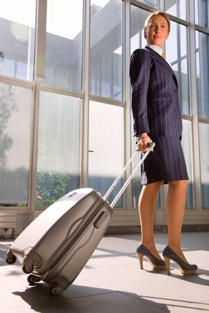 businesswoman with trolley Stock Photo - 9858437