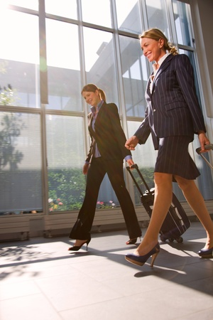 two businesswoman with trolley Stock Photo
