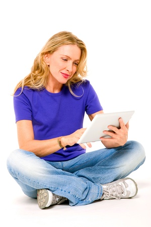 crossed legs: woman using a digital tablet