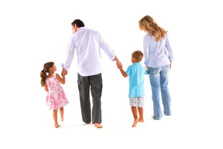 parejas caminando: familia con dos hijos Foto de archivo