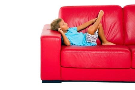 boy on red sofa photo