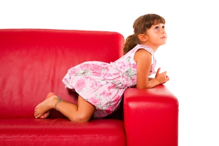 girl on red sofa Stock Photo