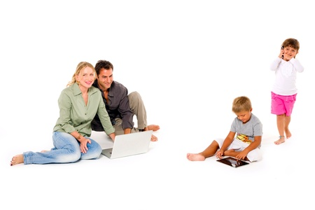 family using digital tablet laptop and mobile Foto de archivo