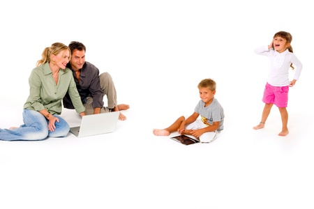 family using digital tablet laptop and mobile Stock Photo