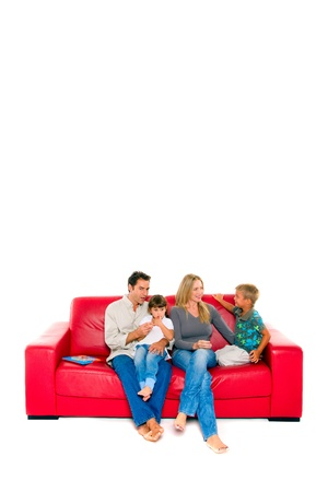 red sofa: family with two children