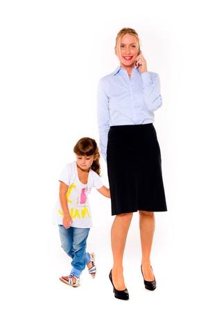 werkende moeder: moeder en dochter Stockfoto