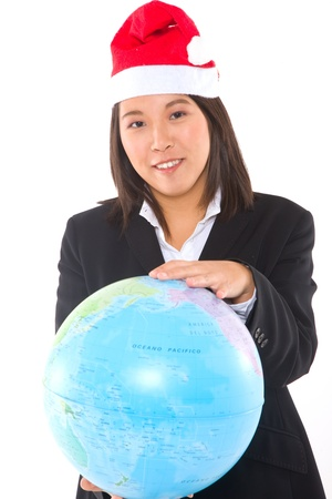 asian businesswoman with santa hat and globe photo