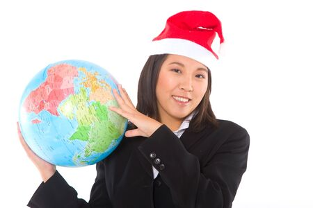 asian businesswoman with santa hat and globe Stock Photo - 11558783