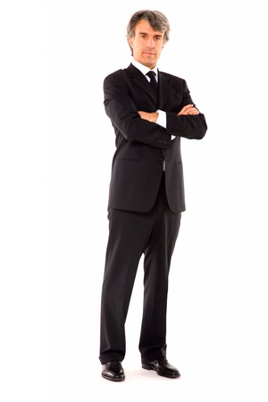 man 40 50: businessman with arms crossed Stock Photo