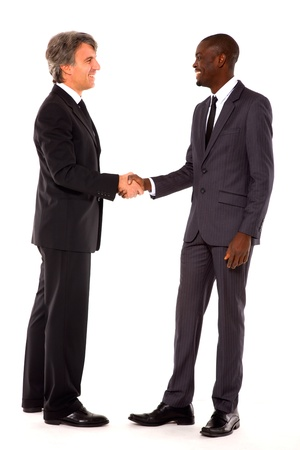 greeting people: businessmen shaking hands