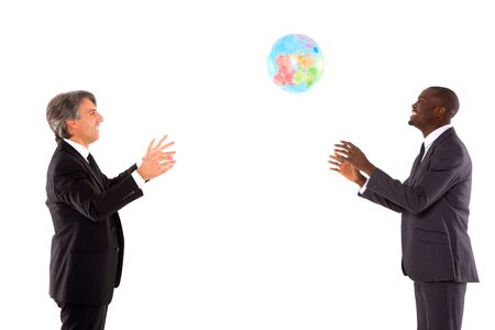 business game: two businessmen playing with a globe