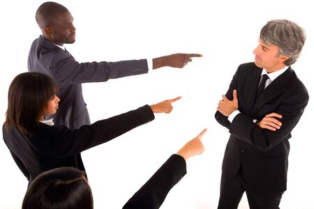 accusing: working team point the finger at a colleague Stock Photo