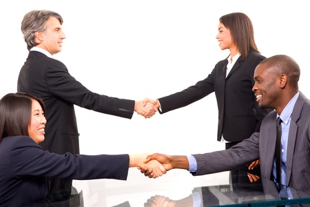 greeting people: multi-ethnic team during a meeting