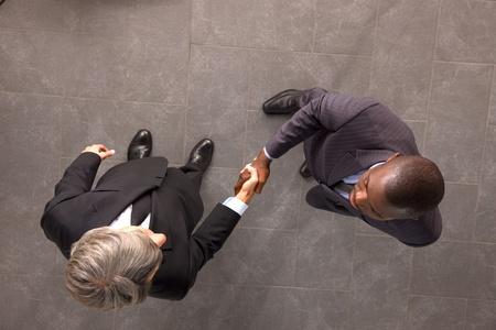 greets: businessmen shaking hands