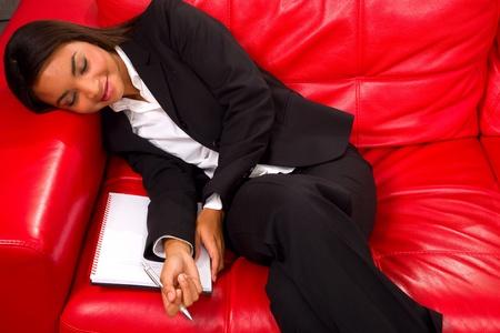 businesswoman sleeping on the sofa photo