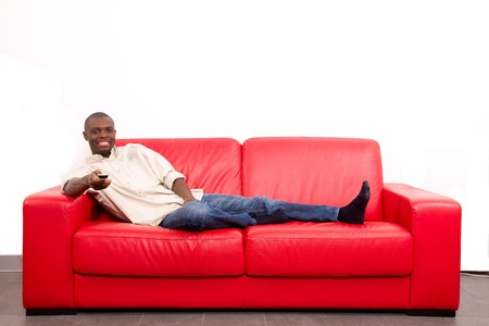 sitted: man on the sofa with remote control