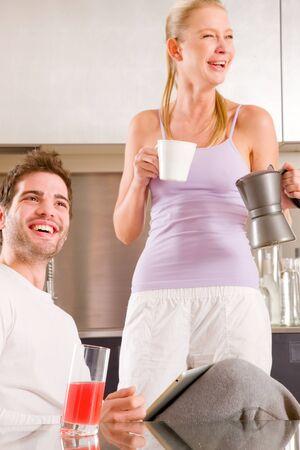 couple in kitchen having breakfast photo