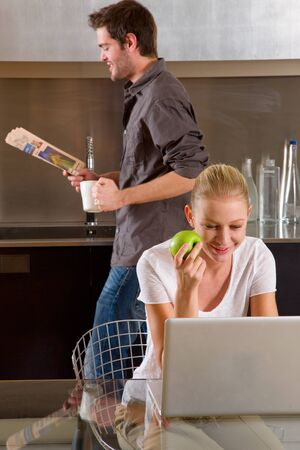 couple at home woman using laptop photo