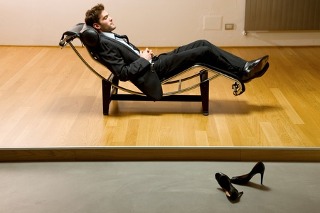 chaise longue: man lying on chaise longue