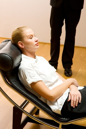 psychiatrist examining a female patient photo