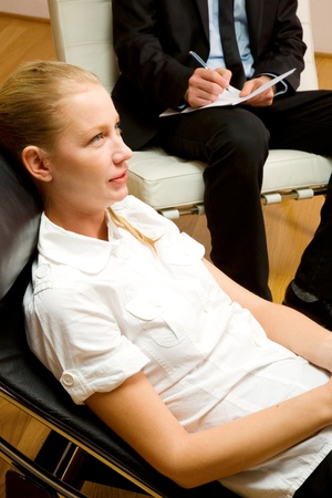 chaise longue: psychiatrist examining a female patient
