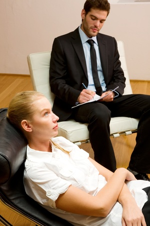 psychologist: psychiatrist examining a female patient