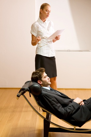 psychotherapy: woman reading man lying on chaise longue