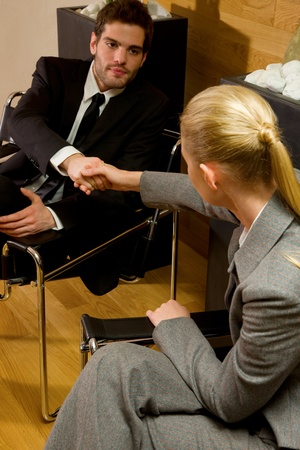 tailleur: business woman and businnes man shaking hands Stock Photo