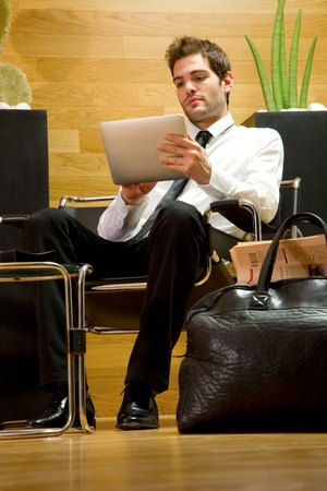 business man waiting in office lobby photo
