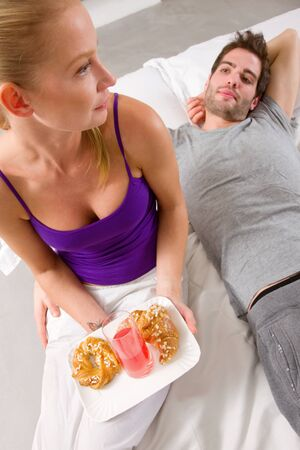 couple having breakfast in bed photo