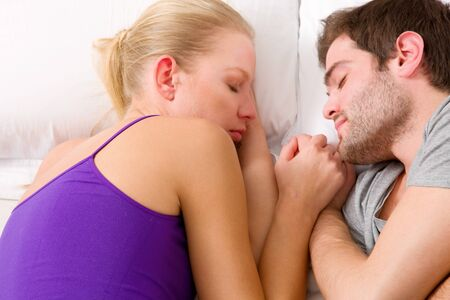 couple lying in bed Stock Photo - 12898466