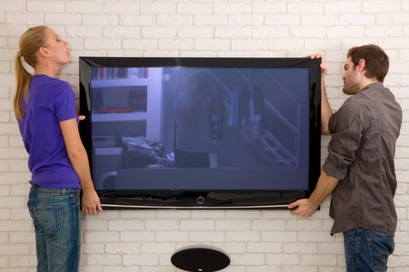 hanging woman: couple hanging television