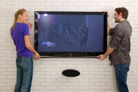 lcd tv: couple hanging television
